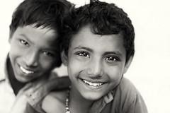 Indian Gypsy boys (Dietmar Temps) Tags: people blackandwhite india boys smile fun 50mm eyes faces outdoor traditional culture streetphotography naturallight ritual tradition ethnic gypsy gypsies ethnology madhyapradesh romani maheshwar ethnie natgeofacesoftheworld