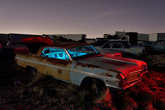 junkyard buick. 2016. (eyetwist) Tags: auto california old longexposure blue light red lightpainting west classic dusty car night truck vintage dark painting photography star buick nikon rust couple long exposure glow desert angle decay details transport wide ruin trails rusty wideangle fullmoon moonlit faded bumper american edge highdesert mojave moonlight weathered junkyard grille nikkor derelict sodium nocturne wrecked trucking patina startrails mojavedesert sodiumvapor lightpollution eyetwist urbanglow npy d7000 capturenx2 eyetwistkevinballuff hollywoodrentals nikond7000 1024mmf3545g