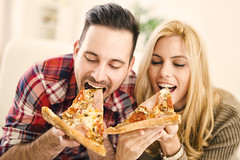 Couple eating pizza (Thunder Stock) Tags: people food men smiling horizontal laughing fun women girlfriend friendship adult drink eating serbia happiness pizza indoors males females youngadult groupofpeople twopeople adultsonly lifestyles youngwomen toothysmile youngmen 2530years caucasianethnicity heterosexualcouple couplerelationship domesticroom positiveemotion 2029years partysocialevent