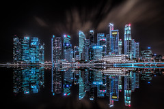 Tron (_skynet) Tags: city longexposure urban reflection tourism skyline architecture night clouds buildings reflections river mirror singapore asia southeastasia cityscape nightscape skyscrapers contemporary illuminated business highrise futuristic finance marinabay luminositymasks