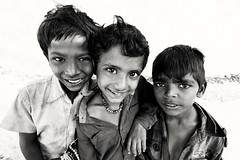 Indian Gypsy boys (Dietmar Temps) Tags: people blackandwhite india boys smile fun eyes faces outdoor traditional culture streetphotography naturallight ritual tradition ethnic gypsy gypsies ethnology madhyapradesh romani maheshwar ethnie