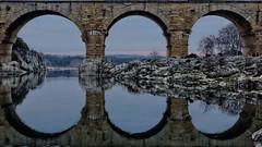 Arch reflection (egeaguy) Tags: bridge france reflection water eau arch roman pierre unesco aqueduct reflet pont pontdugard romain languedoc gard aqueduc nmes arche