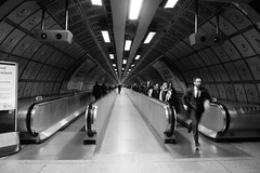 On Way to the Bakerloo Line (cycle.nut66) Tags: leica blackandwhite bw london monochrome contrast underground lumix dynamic tunnel line panasonic summicron waterloo walkway grayscale bakerloo lx3
