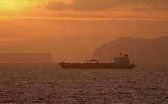 Mercante al amanecer (vic_206) Tags: sea sunrise mar ship amanecer madeira barcomercante canoneos7d canon300f4liscanon14xii