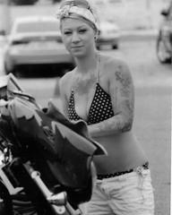 BikiniBikeWasher BullHeadCityUSA (Shot by Newman) Tags: bw bike ink 35mm daylight tattoos bikini blonde ilforddelta400 riverrun bikeweek ilfordfilm laughlinnevada olearyspub bikinibikewash bullheadcityaz shotbynewman bulletpolish
