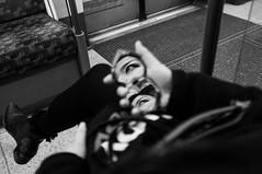 Eyes (Gary Kinsman) Tags: fujix100 fujifilmfinepixx100 2015 london tube northernline tfl londonunderground carriage mirror reflection heart eyes bw blackwhite people person