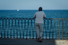 (Antonio_Trogu) Tags: street sea summer italy seascape man boat italia mare looking estate horizon streetphotography uomo solo sicily lonely banister railing lungomare sicilia paesaggio siracusa ortigia orizzonte 2015 ringhiera antoniotrogu nikond3100