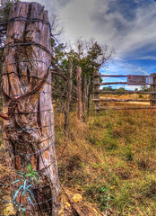 barbed... (Baja Juan) Tags: county blue signs green grass clouds warning fence happy wooden wire skies texas hill fences fencing baja friday posts barbed hdr hff