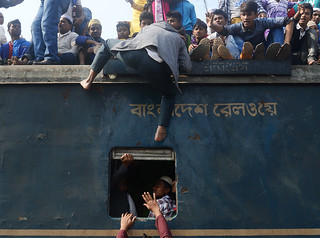 Muslim pilgrims travel by train during Ijtema with risks. Ijtema 2016, Tongi, Bangladesh.