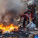 Burning Trash to Scavenge Metal, Tongo Manila, Philippines