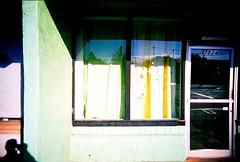 Snow flakes (jfpj) Tags: california snowflake carnival shadow green film yellow fuji toycamera decoration gilroy vivitar plasticcamera trashcam fuji400film vivitarultrawideandslim
