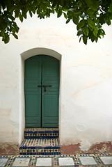 La porte verte (lekconcept) Tags: door tree backyard palace morocco marrakech floortile