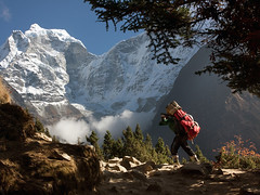 A Sherpa in Nepal (Alex Thetford) Tags: travel nepal snow mountains beautiful climb shot luggage wanderlust collection explore monastery dozen bags sherpa moutain almaty carrying readers tengboche yourshot tengbochenepal dd001