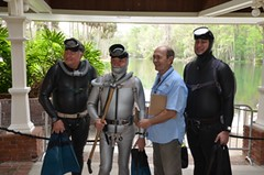 Vintage scuba divers with black and silver vintage smooth rubber wetsuits and double hose regulators. (Vintage Scuba) Tags: woman man men silver fight women gun mask smooth knife diving rubber double hose diver beavertail fins wetsuit tanks spear regulator