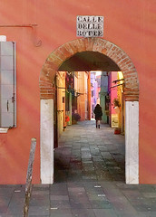 Calle Delle Botte, Burano (VillaRhapsody) Tags: street venice winter italy sunlight colors walking person alley colorful arch colours corridor pedestrian rays behind colourful venezia venedig burano distant citytrip calledellebotte