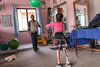 Nirmala throws a ball as she works on her balance during a rehabilitation session with physiotherapist, Jay. (Handicap International UK) Tags: nepal handicapinternational ngo prosthesis physiotherapy rehabilitation nepalearthquake