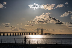 Photographing the Sunset by the Bridge (Infomastern) Tags: bridge sunset sea sky people cloud water himmel bro vatten hav solnedgng moln resundsbron geolocation mnniska geocity camera:make=canon exif:make=canon exif:focallength=50mm brofstet geocountry geostate exif:lens=efs18200mmf3556is exif:aperture=16 exif:isospeed=100 camera:model=canoneos760d exif:model=canoneos760d