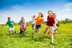 Group Of Happy Running Kids (nnq1011) Tags: girls friends summer people playing black nature boys smile field grass yellow kids race season children landscape fun outdoors happy stand spring team holding child many joy group lawn meadow diversity lifestyle running run dandelion together casual leisure schoolchildren activity six hold active caucasian