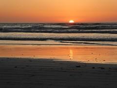Sunset (lgebelin) Tags: world ocean sunset sea orange seascape beach nature coast seaside colorful earth nowhere beautifullight planetearth inthemiddleofnowhere beautifulsunset emptybeach