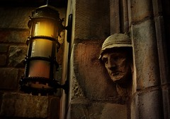 face on wall with lamp (johnsinclair8888) Tags: door old sculpture building brick lamp face stone wall dark out yale