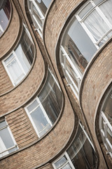 Design: Thirties (masterglass) Tags: old houses abstract detail reflection building london art glass architecture lens prime design thirties arch apartment bend bricks curves structure flats walls 1930 135mm postwar charterhouse curving innovative