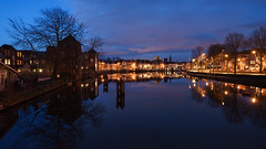 Twilight Zone (McQuaide Photography) Tags: city longexposure winter light cold holland reflection building haarlem water netherlands spaarne dutch skyline architecture zeiss photoshop river landscape outside licht twilight lowlight europe waterfront outdoor dusk availablelight widescreen sony tripod nederland wideangle panoramic bluehour fullframe alpha 169 waterside stad manfrotto noordholland gebouw schemering lightroom waterscape koud rivier wideanglelens 1635mm northholland a7ii groothoek variotessar koudenhorn mirrorless sonyzeiss binnenspaarne mcquaidephotography ilce7m2