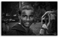 Melancholy! (FotographyKS!) Tags: poverty street boy portrait blackandwhite bw black abandoned smile face childhood closeup contrast work dark sadness nikon focus village child sad looking emotion head expression african labor small poor hard young streetphotography social human single exploitation labour depressed nikkor population tragic hindu stress unhappy nikondigital injustice grief underage childlabour ethnicity contrasty lifestyles scarcity 35mmf2d indigeneous childrights younsters nationalchildlabourproject childlabouract lackofsocialsecurity