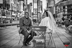 Wedding Couple Times Square NYC (Street Photo NYC) Tags: city nyc wedding people blackandwhite bw ny newyork streets monochrome groom bride blackwhite nikon couple married manhattan candid streetphotography timessquare streetphoto d600 streetphotonyc