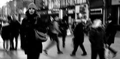 The World Moves On (Owen J Fitzpatrick) Tags: ojf people photography nikon fitzpatrick owen j joe street pavement chasing d3100 ireland editorial use only ojfitzpatrick eire dublin republic city candid tamron oconnell unposed social crowd crowded movement woman beauty beautiful attractive handbag hat face coat walk pedestrian world moves bw mono monochrome blackwhite blackandwhite black white candidphoto candidphotography candidportrait natural blancoynegro pretoebranco schwarzundweis  hiybi  hi y bi nigra kaj blanka    aswd w abyad czarny biay kaala aur saphed