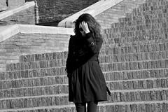 shy (Stefano E) Tags: street people urban blackandwhite italy girl sunglasses strada italia candid shy curly ricci staircase biancoenero ragazza emiliaromagna comacchio timida scalinata occhialidasole