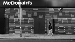 Kilburn, London 2016(4) (S.R.Murphy) Tags: fujix100t kilburn london march2016 socialdocumentary streetphotography monochrome mono bw blackandwhite whiteandblack shop people hamburger burger mcdonalds text monchrome
