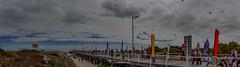 Semaphore International Kite Festival 1 (johnwilliamson4) Tags: panorama clouds landscape flag jetty crowd australia kites adelaide southaustralia semaphore lifeguardtower internationalkitefestival