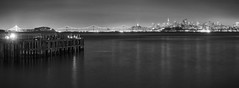 An evening of escape (PeterThoeny) Tags: sanfrancisco california city longexposure bridge blackandwhite panorama reflection water monochrome skyline night bay pier downtown raw outdoor clear baybridge sanfranciscobay sausalito hdr cityskyline photomatix fav200 1xp nex6 selp1650