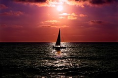 sailing at sunset - Tel-Aviv beach (Lior. L) Tags: sunset sea beach silhouette sailboat wow telaviv sailing sailingatsunsettelavivbeach