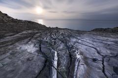 Nightfall (SimonMastersPhotography) Tags: uk blue light sea moon tree night branch mud stuck landslide cluds