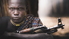 Marmol (Cyril Blanchard) Tags: voyage africa travel portrait man color expedition horizontal closeup canon one gun military smoke traditional young 85mm tribes omovalley tradition ethiopia tribe ethnic 169 mago mursi reportage marmol afrique armed thiopien etiopia youngboy traditionalclothing etiopa africantradition foreignpeople africanpeople  africanethnicity mursitribe indigenousculture etipia kalachnikov stronglook  traditionallifestyle mursis magonationalpark  interestinglook valledelomo 5dmarkiii  magopark tribuafricaine southernnations omotribe indigeneousculture  traditionafricaine ethniedafrique ethniesdafriques vtementstraditionnelsafricains portraitdetributraditionnel portraitdelavalledelomo portraitsdelavalledelomo omovalleyportrait omovalleyexpedition omovalleyreportage reportagesurlavalledelomo expeditionsurlavalledelomo