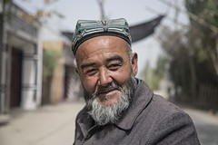 Hotan 635 (PEOPLEIMEET) Tags: life china street old travel people man fruit race portraits beard photography one shanghai faces time retrato no tiger muslim islam ngc border chinese beijing streetphotography uighur xinjiang kashgar zodiac  uyghur wisdom tradition stories region wrinkles ritratto cina humans portre  portrat gabor  streetportraits  onerace  potret noborders hony   peopleimeet peopleinchina oldfaces  humansofnewyork humansof humansofchina humansofshanghai humansofbeijing