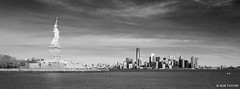 New York Skyline Landscape Statue of Liberty and Downtown Manhattan USA (rtmotorphotos) Tags: city newyork skyline canon river landscape mono blackwhite downtown skies cityscape manhattan cities sigma rivers 7d statueofliberty freedomtower 18250 libertisland oneworldtradecentre