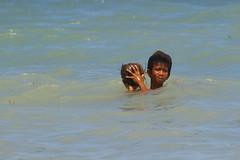 Boy holding coconut, Bulabog Beach, Boracay island, Western Visayas, Philippines (Darius Travel Photography) Tags: pentax philippines boracay filipinas pilipinas boracayisland    pentaxk100dsuper   filipinai