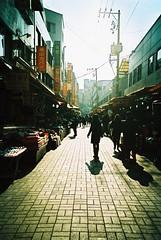Street Scene - Busan (Shoji Kawabata. a.k.a. strange_ojisan) Tags: film analog 35mm landscape landscapes lomo lca xpro lomography asia cross korea east crossprocessing busan processing land analogphotography eastasia pohang analogphoto filmphotography filmphoto scpae slide200