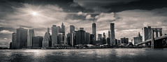 Manhattan Pano (King Grecko) Tags: nyc newyorkcity usa sun ny newyork reflection architecture america skyscraper canon cityscape unitedstates manhattan wallart business brooklynbridge flare wtc iconic financial bigapple lightroom splittoned businessdistrict