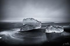Glass-like iceberg (Million-photo) Tags: ocean sea cloud mer black ice beach landscape iceland sand long exposure noir sable exposition nd iceberg nuage paysage plage jokulsarlon glace islande longue