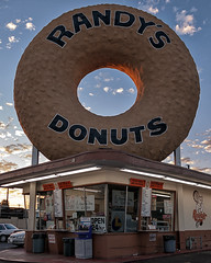 randy's donuts. inglewood, ca. 2006. (eyetwist) Tags: california street sunset urban postprocessed hot color sign typography la losangeles los saturated nikon exposure hole angeles details famous kitsch landmark fresh socal filter donuts snack donut signage processing type coolpix americana plugin nik westside lax processed randys westla inglewood typographic ptlens 8700 randysdonuts giantdonut angeleno e8700 reprocessed eyetwist nikcolorefex eyetwistkevinballuff americantypologies