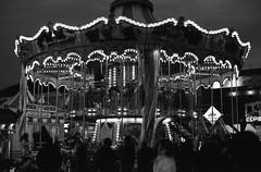 Carousel 2 (Mel Enc) Tags: sanfrancisco california blackandwhite bw slr analog 35mm canon 50mm pier blackwhite kodak ae1 tmax 35mmfilm embarcadero epson v600 pier39 prim standardlens primelens fd50mmf14 135film