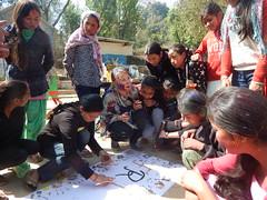 Scholars busy creating a handmade banner (rukmini_foundation) Tags: nepal colors celebration holi didi mentoring
