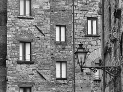 a volterra (Sergey S Ponomarev) Tags: city travel windows winter texture tourism lamp stone canon pattern volterra medieval bn finestra journey tuscany february toscana citta febbraio 2016           70d    sergeyponomarev ef24105f40l  bianceenero