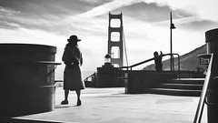 Golden Gate National Recreation Area (MP Roopesh) Tags: california camera bridge blackandwhite woman hat lady clouds asian photography highway afternoon looking unitedstates pacific steps pacificocean goldengatebridge goldengate takingphoto californiacity roopesh goldengaterecreationalarea mproopesh