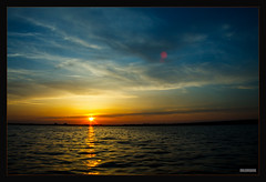 Mggelsee (MLursus) Tags: blue sunset orange black berlin water yellow canon germany eos dawn wasser sonnenuntergang gelb blau schwarz 2016 mggelsee 50d mlursus
