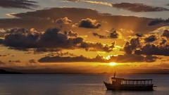 sunset boat (sami kuosmanen) Tags: ocean travel light sunset red sea brazil sky orange cloud sun colors clouds america landscape photography boat grande colorful ray outdoor bahia peninsula barra meri brasilia maisema luonto vene marau sde pilvi oranssi laiva amerikka taivas suoth tumma etel niemimaa