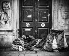 A tender moment (tootdood) Tags: people blackandwhite manchester couple sitting homeless piccadilly sit sat moment seated tender fromthehip pleasehelp streetcandid canon70d